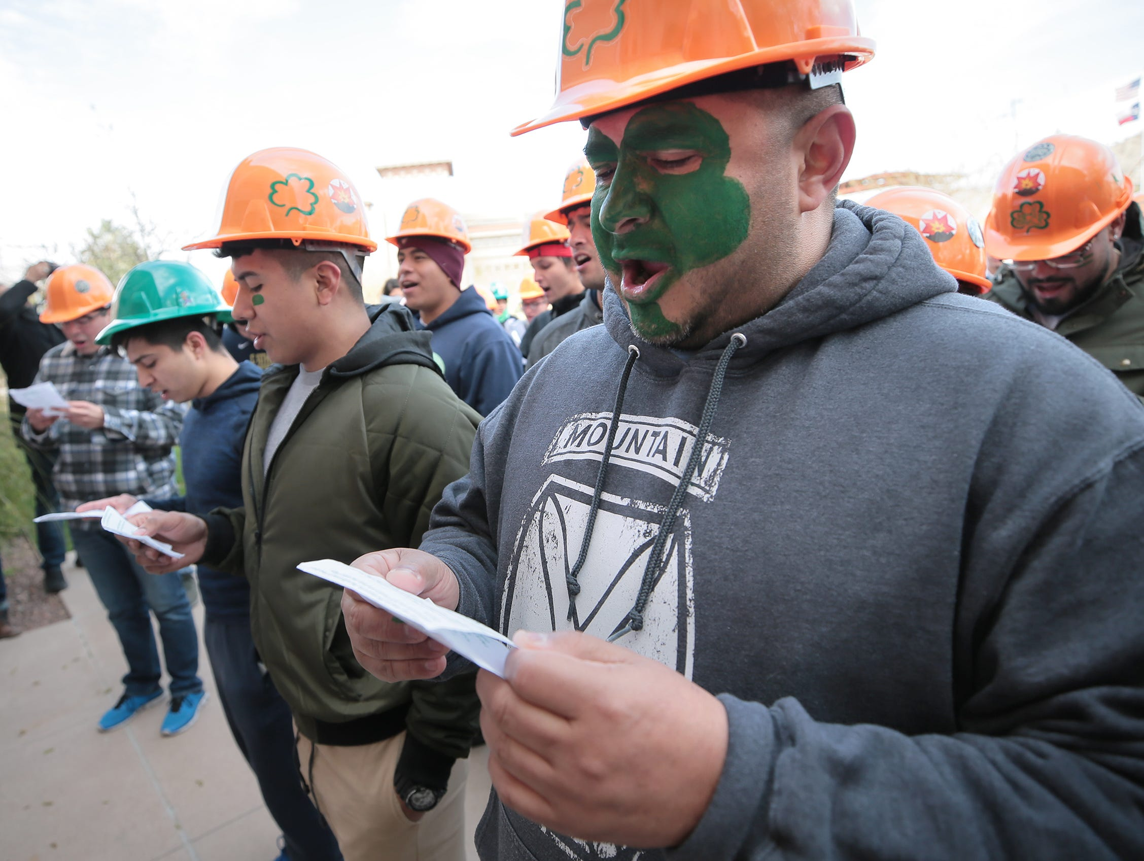 """UTEP Engineering students participated in Texas College of Mines day on campus. The day of events began with a serenade of UTEP President Dr. Diana Natalicio. Students then marched to the """"M"""" for a white washing followed by several other events. TCM Day reminds students of the school's roots and honors the patron saint of engineering, St. Patrick."""
