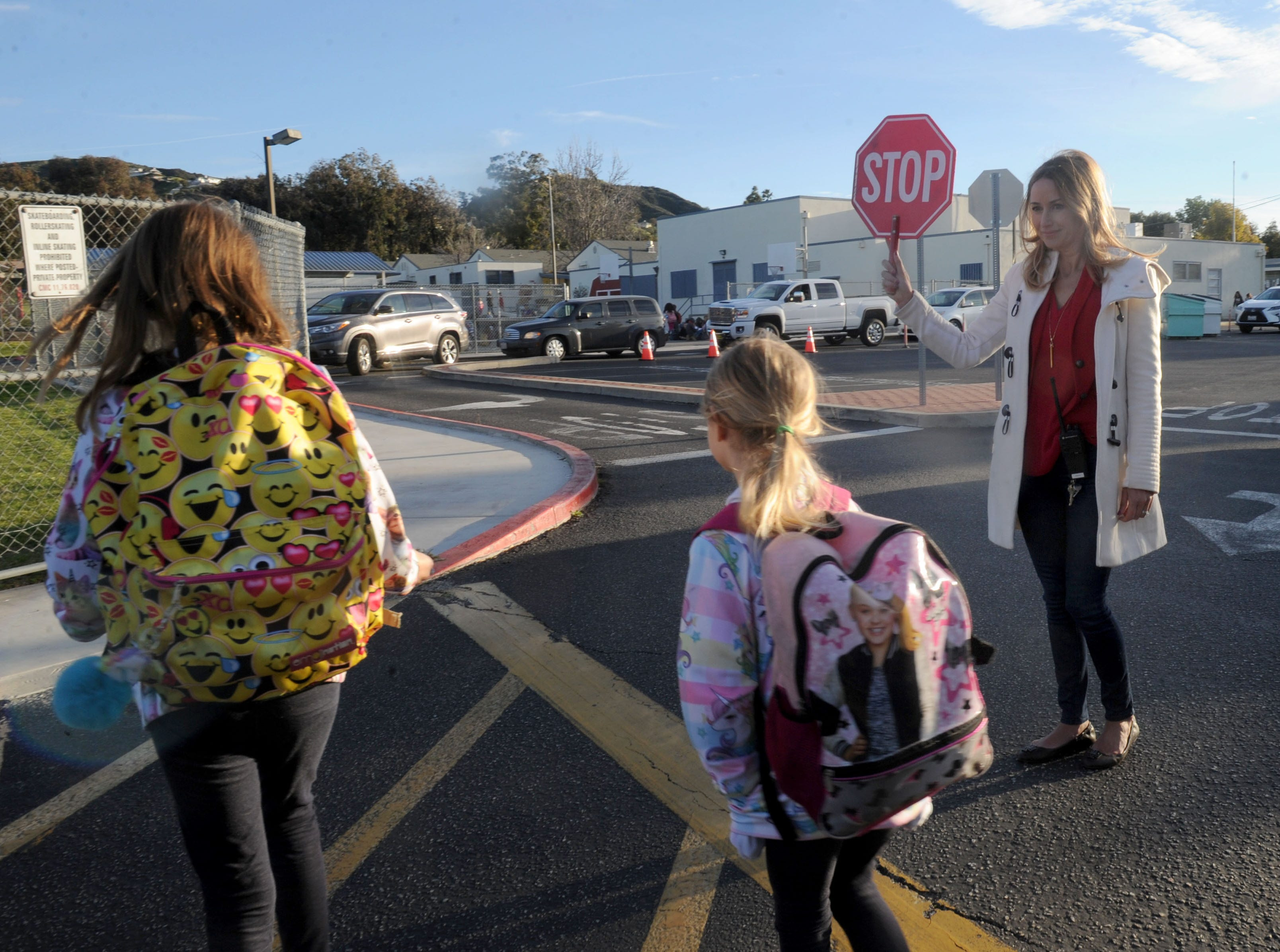 Claudia Stepan, principal at Camarillo Heights School, stops traffic so her students can cross the street.The school is the oldest operating school that has always been part of the Pleasant Valley School District, which is celebrating its 150th anniversary at a celebration later this month.