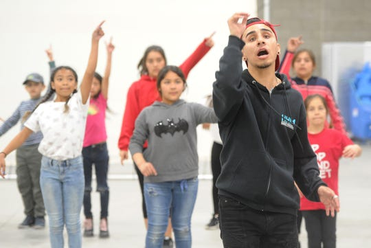 Alex Barrajas, instructor with dance program Hip Hop Mindset, practices with students at Rio Del Sol School in Oxnard. The students with Hip Hop Mindset will perform in the second Hip Hop Ballet on March 26 and 27 at the Oxnard Performing Arts Center. The event is free to all.