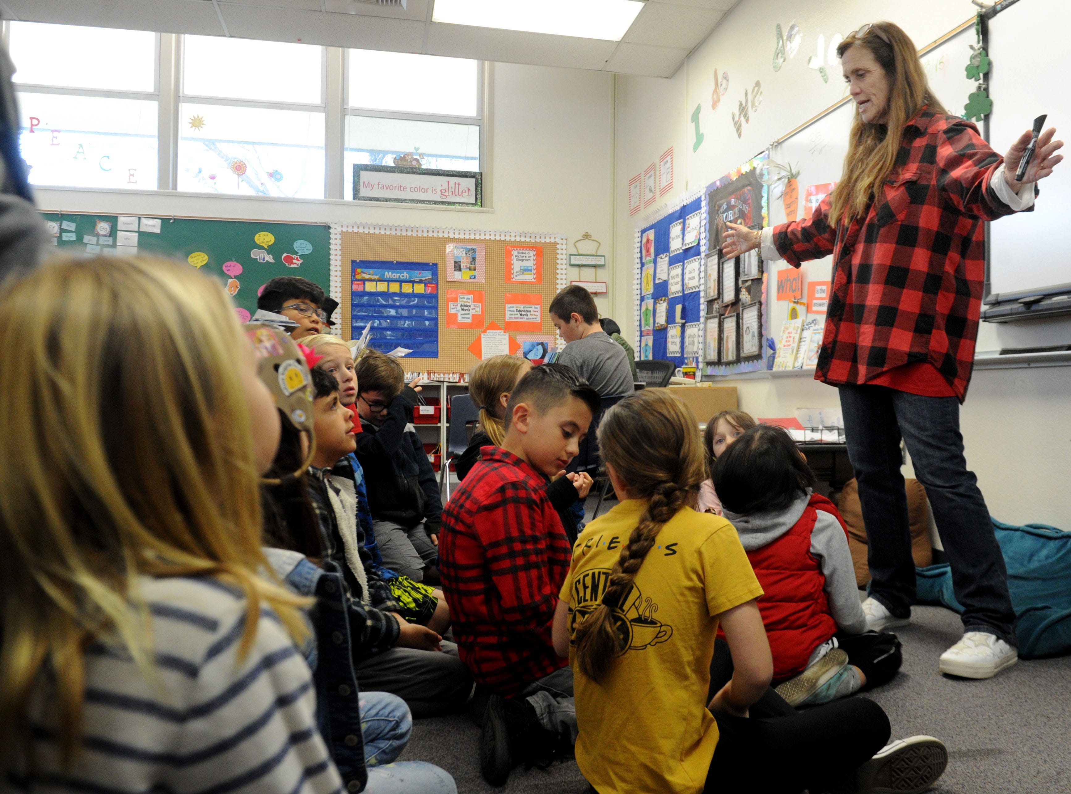 Jodi Atkinson, a second-grade teacher at Camarillo Heights School, works with her students. Atkinson also attended the school as a student.
