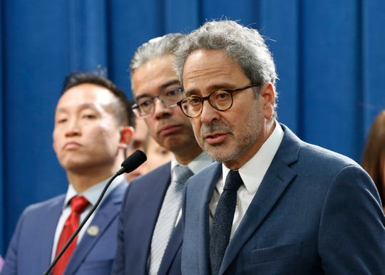 Assemblyman Richard Bloom, D-Santa Monica, right, discusses his proposed rent control measure at a news conference Thursday in Sacramento. Bloom along with Assemblymen David Chiu, D-San. Francisco, left, Rob Bonta, D-Alameda, center, and Buffy Wicks, D-Oakland, unseen, introduced a package of bills to tamp down on rising rents.
