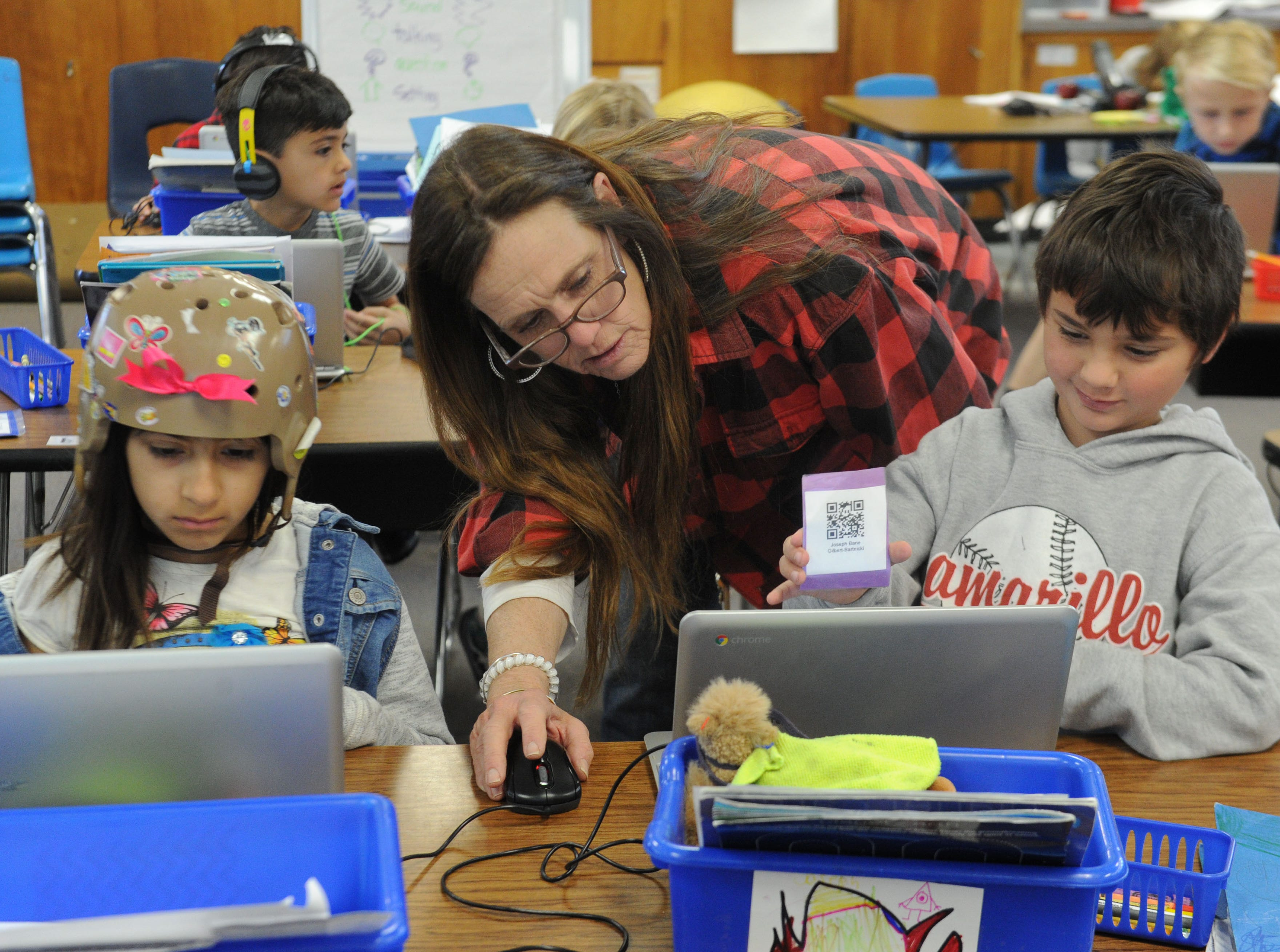 Roxi Arroyo, left, works on her math as second-grade teacher Jodi Atkinson works with Joseph Bartnicki at Camarillo Heights School. Atkinson also was a student at Camarillo Heights. The school is the oldest operating school that has always been part of the Pleasant Valley School District, which is celebrating its 150th birthday this year.