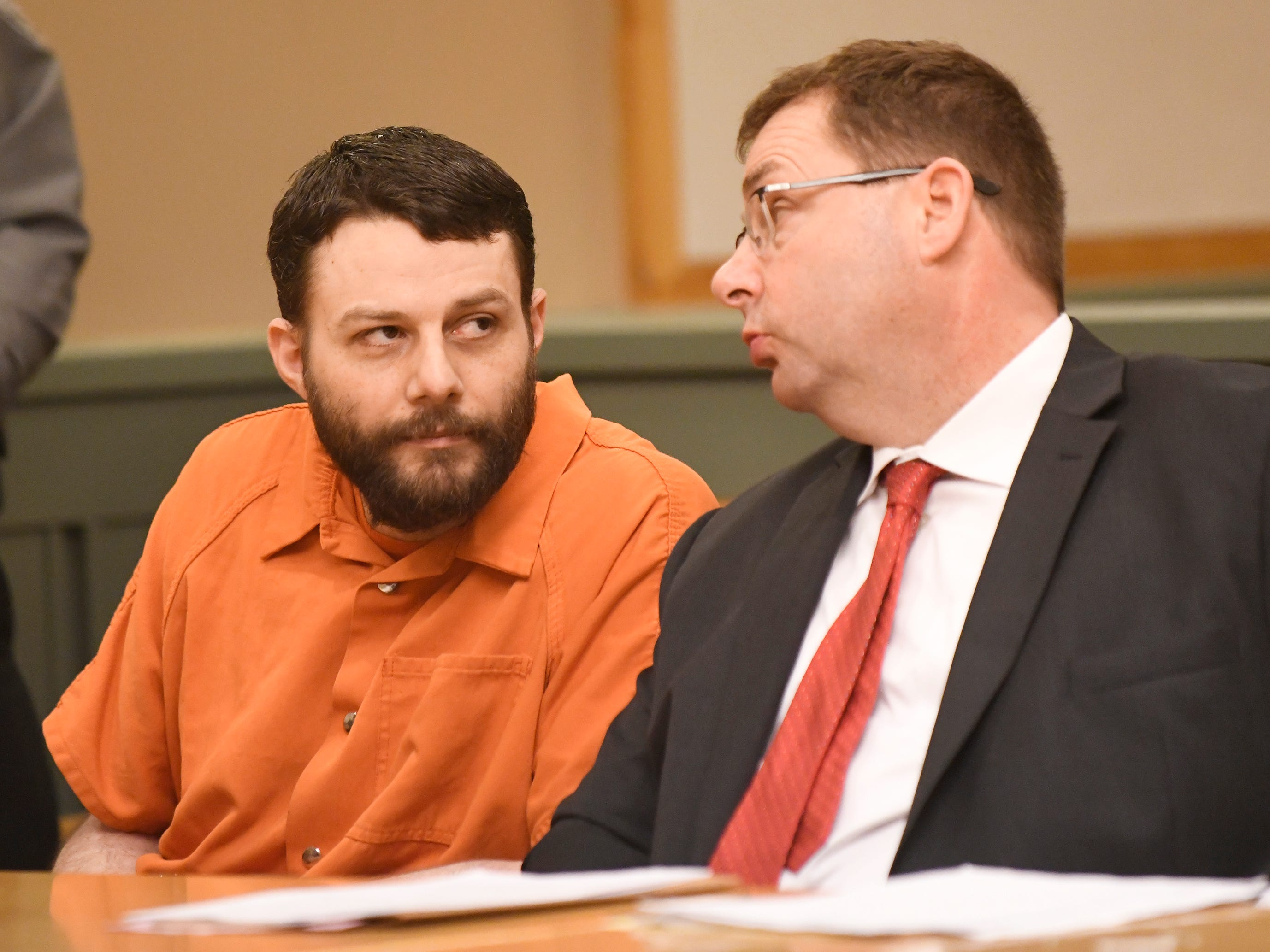 Jeremiah E. Monell, left, speaks with his defense attorney Nathan Perry in Cumberland County Superior Court on Friday, Mar. 15, 2019. Monell was sentenced to life in prison in the 2016 murder of his estranged wife, Tara O'Shea-Watson.