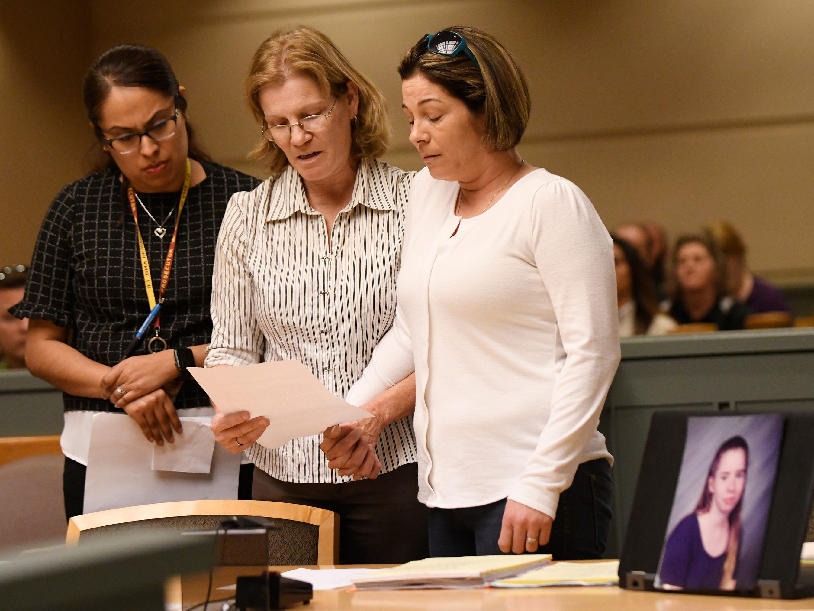 Family members of Tara O'Shea-Watson speak during the sentencing of Jeremiah E. Monell in Cumberland County Superior Court on Friday, Mar. 15, 2019. Monell, who stabbed and slashed his estranged wife to death, was sentenced to spend the rest of his life in a state prison.