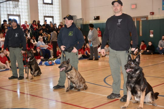 Veterans Memorial School recently celebrated K-9s with a demonstration by the Vineland Police Department's K-9 unit. The school has dedicated a hallway to recognize K-9 military veterans as it marked National K-9 Veterans Day. Artifacts from handlers who served with their dogs in various wars were donated to the school and are now on display in the eighth-grade wing.