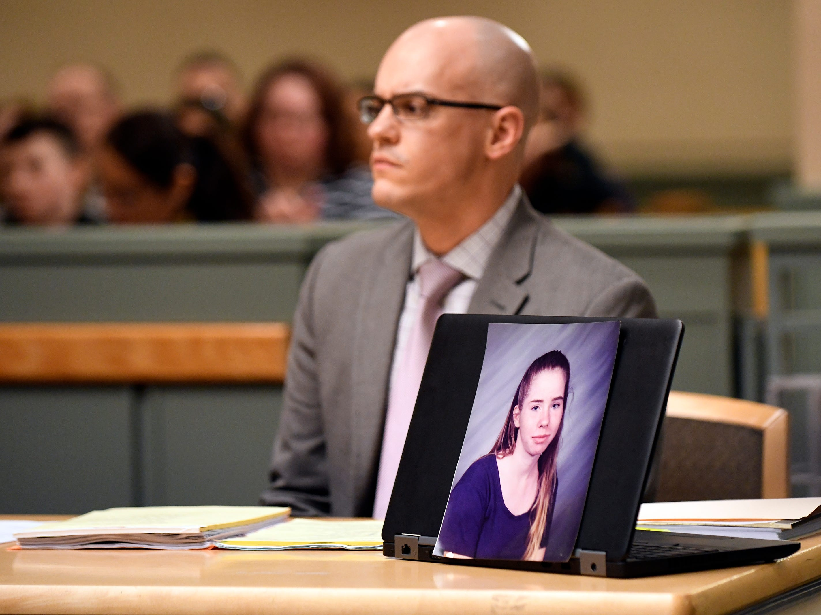 A picture of the late Tara O'Shea-Watson sits on a desk in front of County Assistant Prosecutor Charles Wettstein during Jeremiah E. Monell's sentencing.
