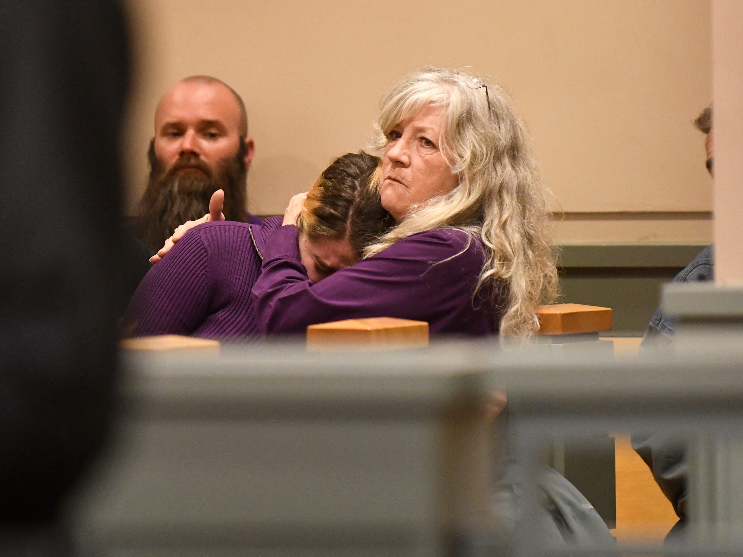 Emily O'Shea, the victim's mother, listens to statements during the sentencing of Jeremiah E. Monell in Cumberland County Superior Court on Friday, Mar. 15, 2019.