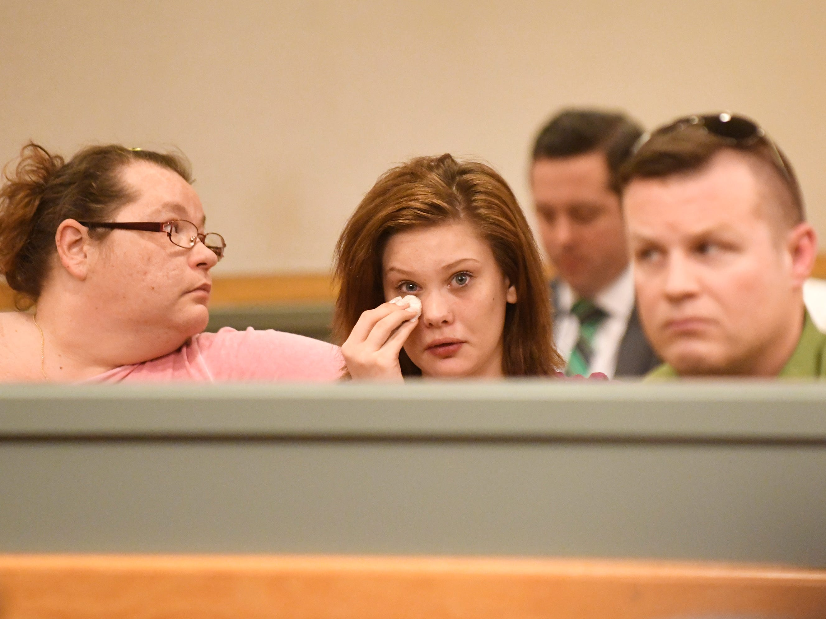 Audience members listen to statements from Tara O'Shea-Watson's family during the sentencing of Jeremiah E. Monell in Cumberland County Superior Court on Friday, Mar. 15, 2019.
