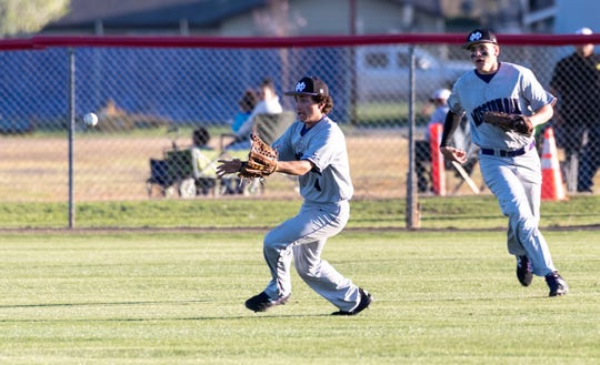 Mission Oak's Nate Watson, left, and Jordan Santos converge on a  hit ball against Tulare Western in an East Yosemite League high school baseball game on Thursday, March 14, 2019.