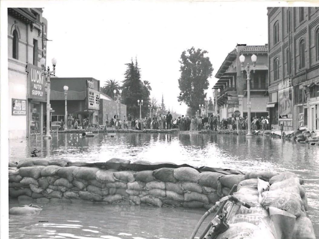 """In this photo from the December 1955 flood, downtown Visalia looks like a """"sandbag river."""""""