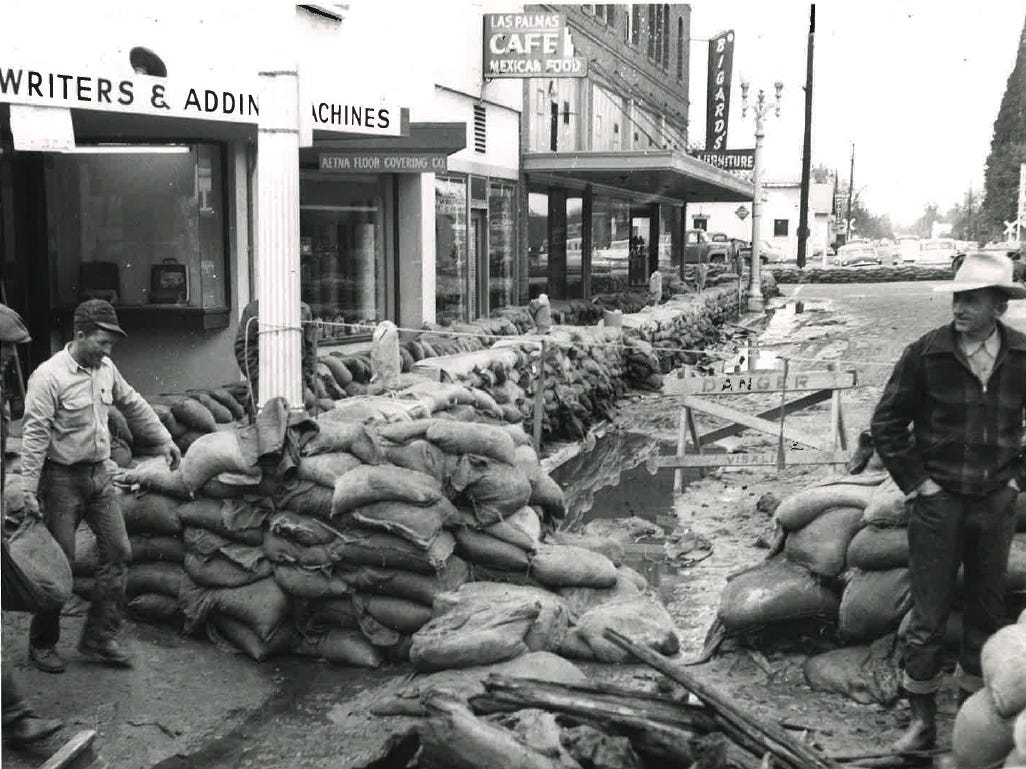 In this photo from the December 1955 flood, sandbags and debris litter downtown Visalia streets.