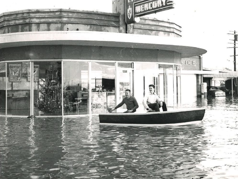 In this photo from the December 1955 flood, two young men float in floodwaters.