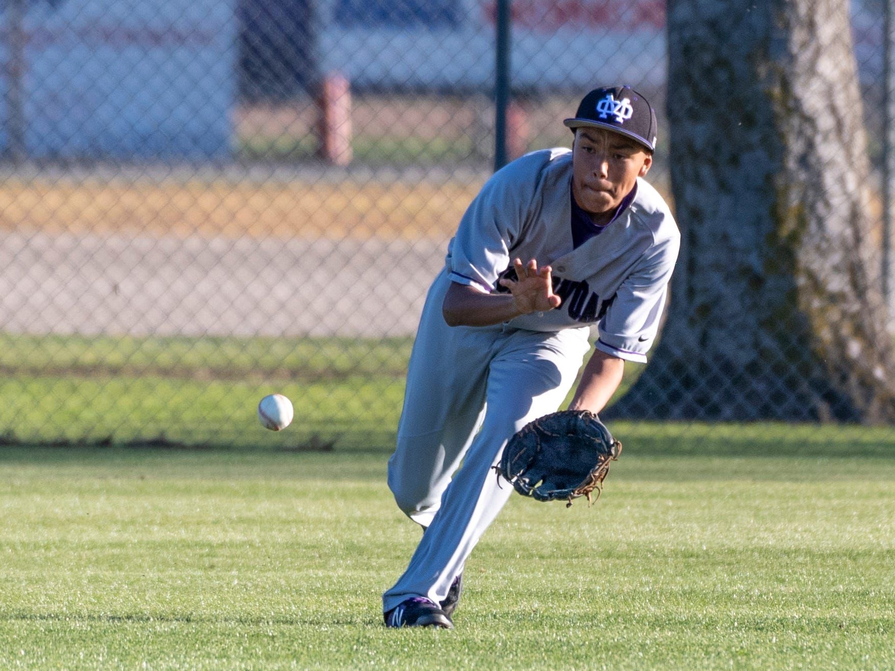 \mo06\ fields a hit ball agsinstTulare Western in an East Yosemite League high school baseball game on Thursday, March 14, 2019.