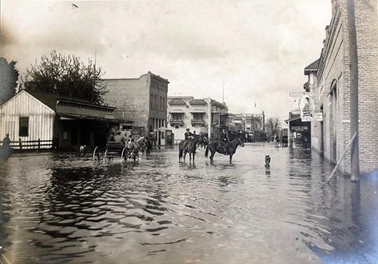 A photo shows the west view of Visalia's Main Street after the 1906 flood.