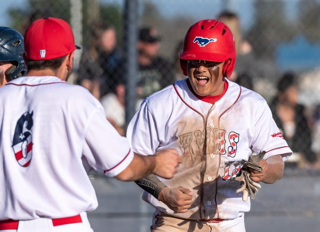 Tulare Western's TJ Martinez celebrates a run against Mission Oak in an East Yosemite League high school baseball game on Thursday, March 14, 2019.