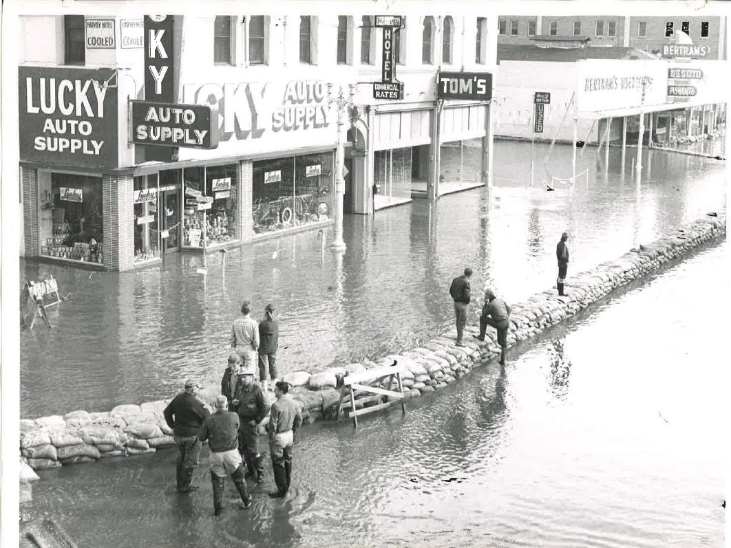 In this photo from the December 1955 flood, a barricade of sandbags splits floodwaters downtown.