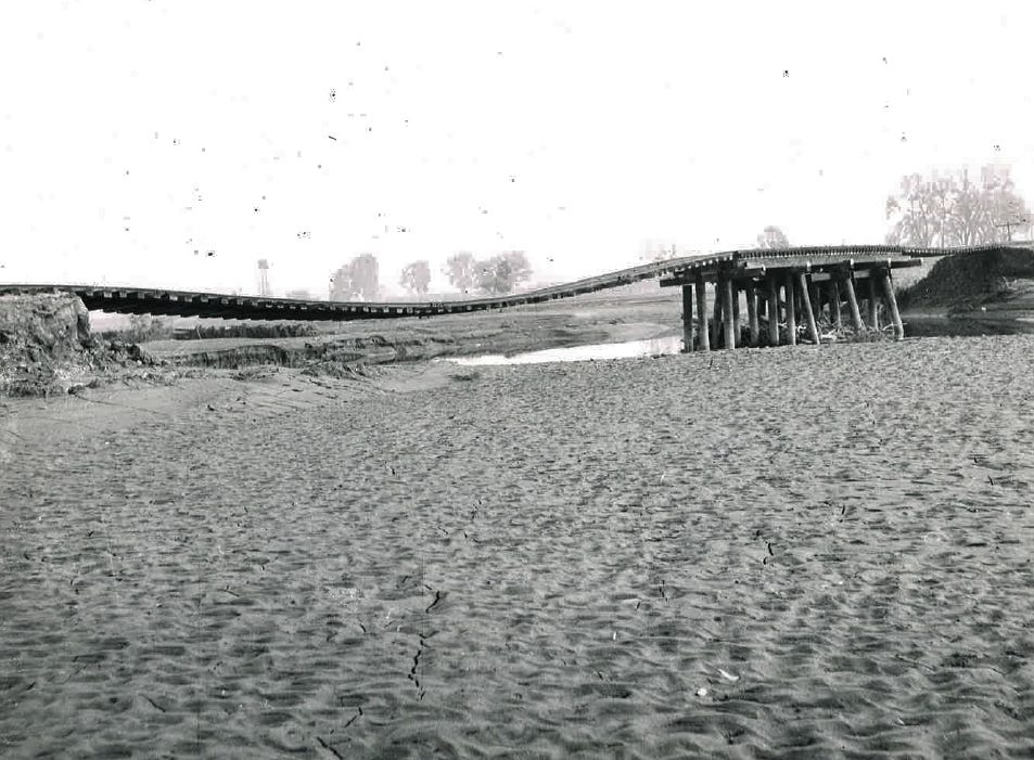 In this photo from the December 1955 flood, a part of the washed out Santa Fe track resembles a roller coaster.