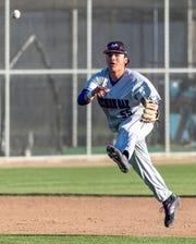 Mission Oak's Nick Alvarado throws to first against Tulare Western in an East Yosemite League high school baseball game on Thursday, March 14, 2019.
