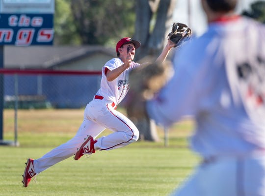 Tulare Western's Will Senn grabs a ball off the bat of Mission Oak's Trevor Barnhart in an East Yosemite League high school baseball game on Thursday, March 14, 2019.