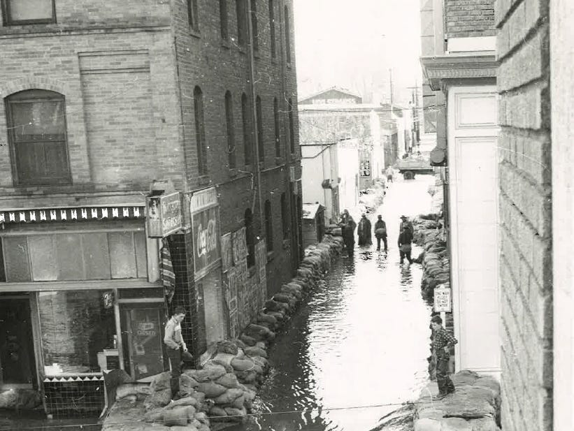 In this photo from the December 1955 flood, sandbags line an alleyway in downtown Visalia.