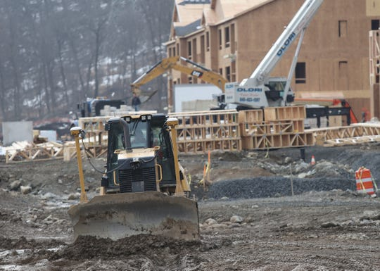 A dozer clears dirt and mud from a temporary road way on the construction site of Woodmont Hills at Ramapo in Sloatsburg on Friday, March 15, 2019.