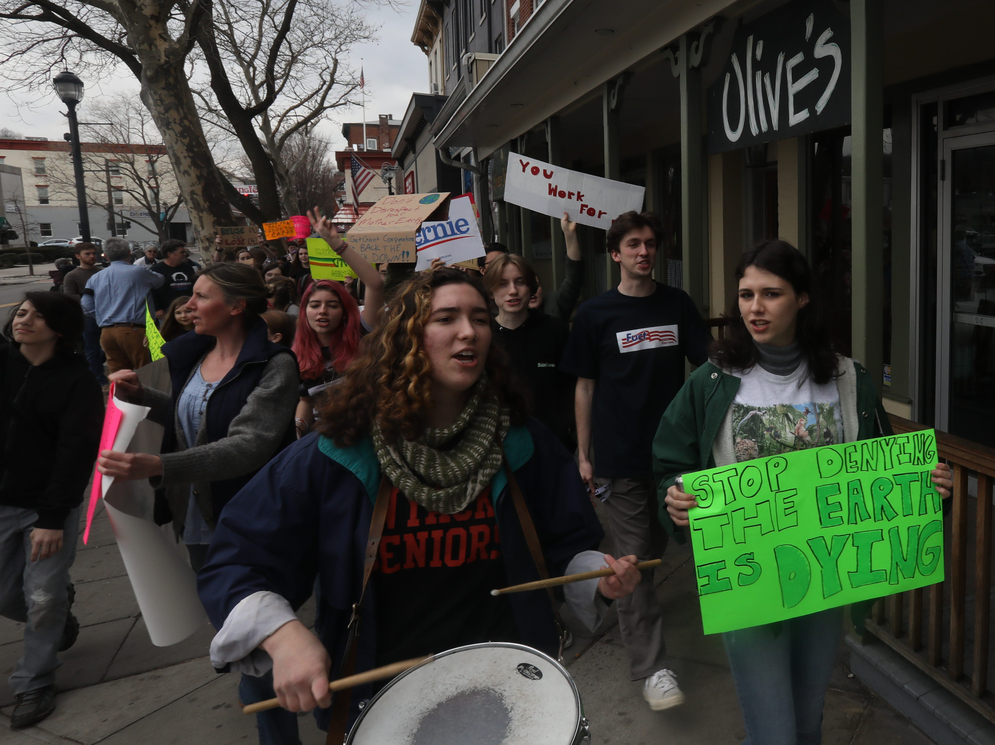 From left, Co-president of Nyack environment club Lucinda Carroll and Julie Tighe march with students inÊRockland County after walking out of school to protest global climate change and demand more aggressive policies to protect the environment in Nyack March 15, 2019.
