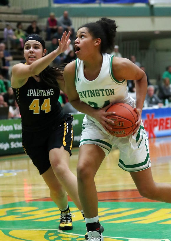 Irvington's Grace Thybulle (24) drives to the basket in front of South Jefferson's Alyssa Stevenson (44)  during the girls Class B state semifinal at Hudson Valley Community College in Troy March 15, 2019. Irvington won the game 42-39.