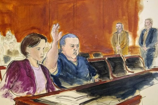 FILE- In this Nov. 6, 2018, file courtroom sketch, pipe bombs suspect Cesar Sayoc raises his arm to swear to the truth of his statement of need for assigned counsel, at Federal Court in New York. Sayoc, who is charged with sending pipe bombs to prominent critics of President Donald Trump, is expected to plead guilty at a hearing in New York on Thursday, March 21, 2019. (Elizabeth Williams via AP, File)