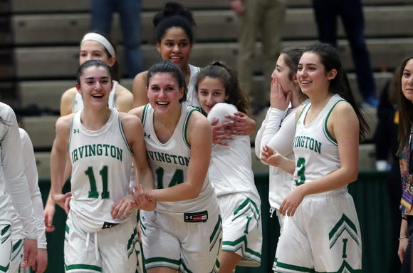 Irvington players celebrate their 42-39 victory over South Jefferson in the girls Class B state semifinal at Hudson Valley Community College in Troy March 15, 2019.