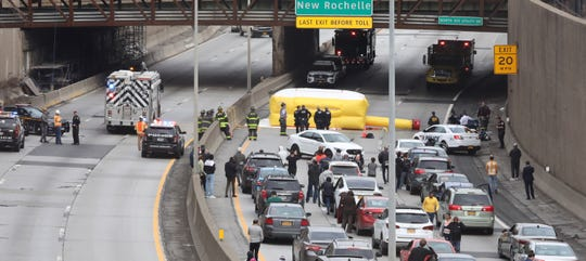 The scene on Interstate 95 as police dealt with a man stands over the side of the North Avenue overpass in New Rochelle, Friday, March 15, 2019. The incident closed I-95 in both directions and backed up traffic for miles.