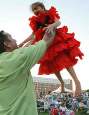 John Jenkins swings his daughter Ella, 6, as the band plays at Bromberg's Big Noise in 2010.