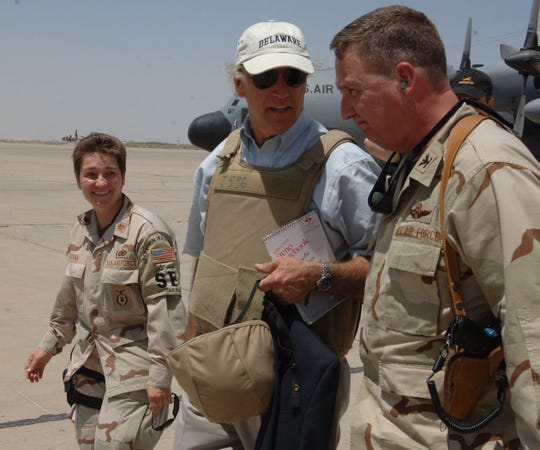 Then Delaware Sen. Joe Biden meets with Air Force Col. Ron Rutland, 447th Air Expeditionary Group commander, and Delaware native Maj. Laura Soule after landing at Baghdad International Airport in Iraq July 7, 2006.