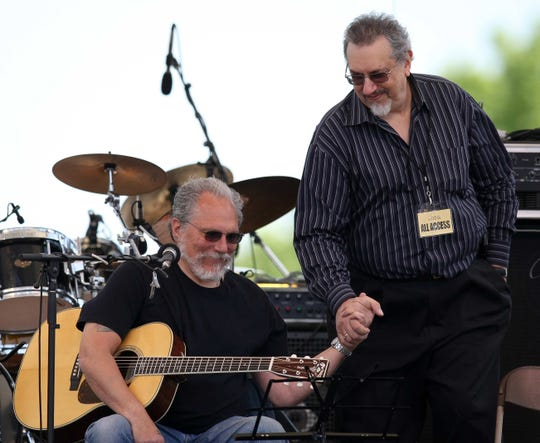 David Bromberg shakes hands with Jorma Kaukonen, founding member of Jefferson Airplane, at Bromberg's Big Noise in 2010.