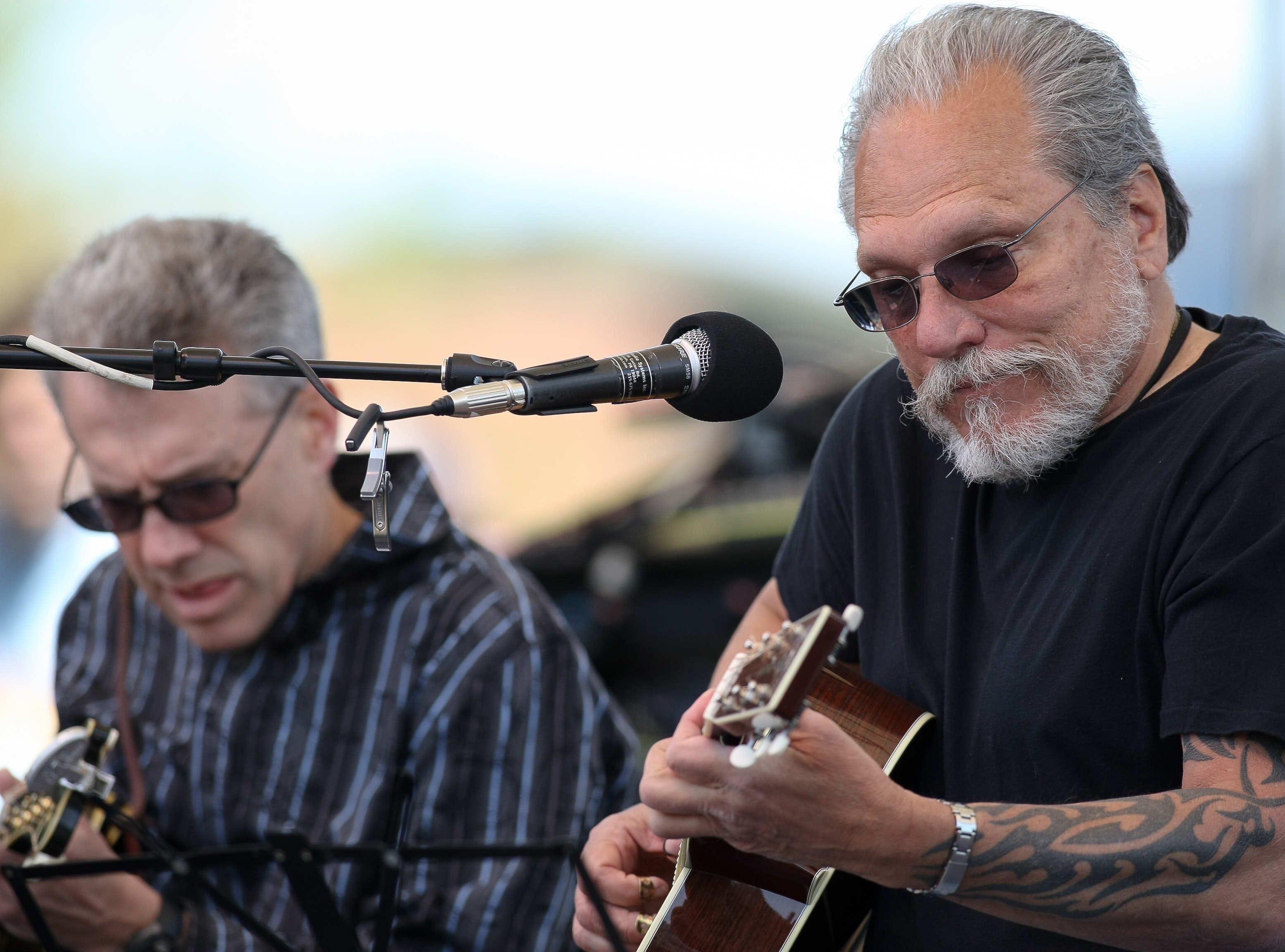 Jorma Kaukonen (right), founding member of Jefferson Airplane and member of Hot Tuna, performs at Bromberg's Big Noise in 2010.