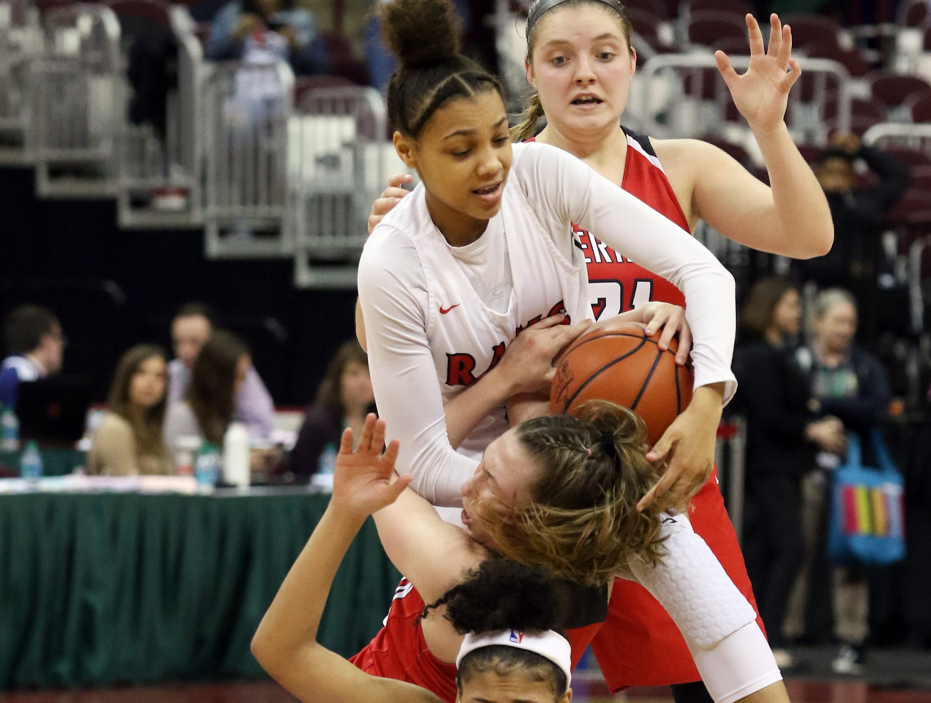 Sheridan's Bailey Beckstedt fights for the ball with Rogers' Logen Love during the Division II state semifinals in Columbus on Thursday. Also involved in the play are Sheridan's Kendyl Mick and Rogers' Cortney Gardner (24).