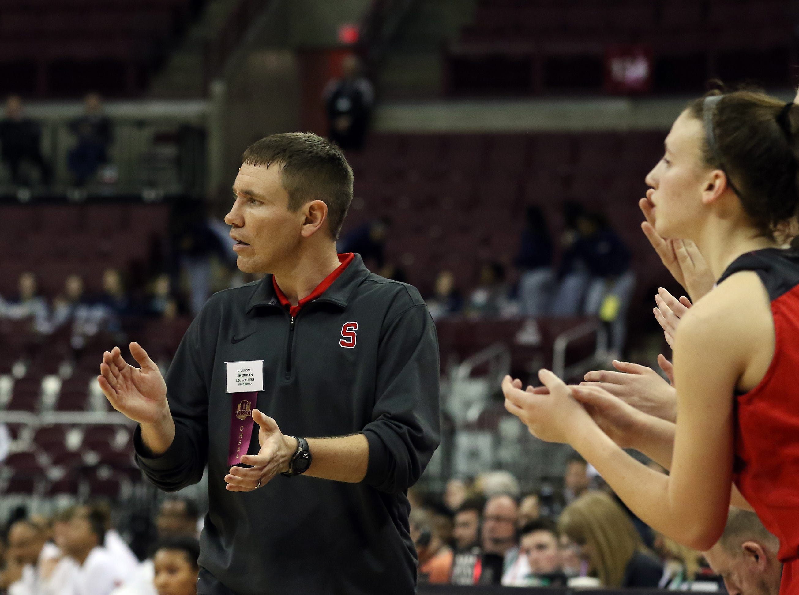Sheridan coach J.D. Walters claps during the Division II state semis.