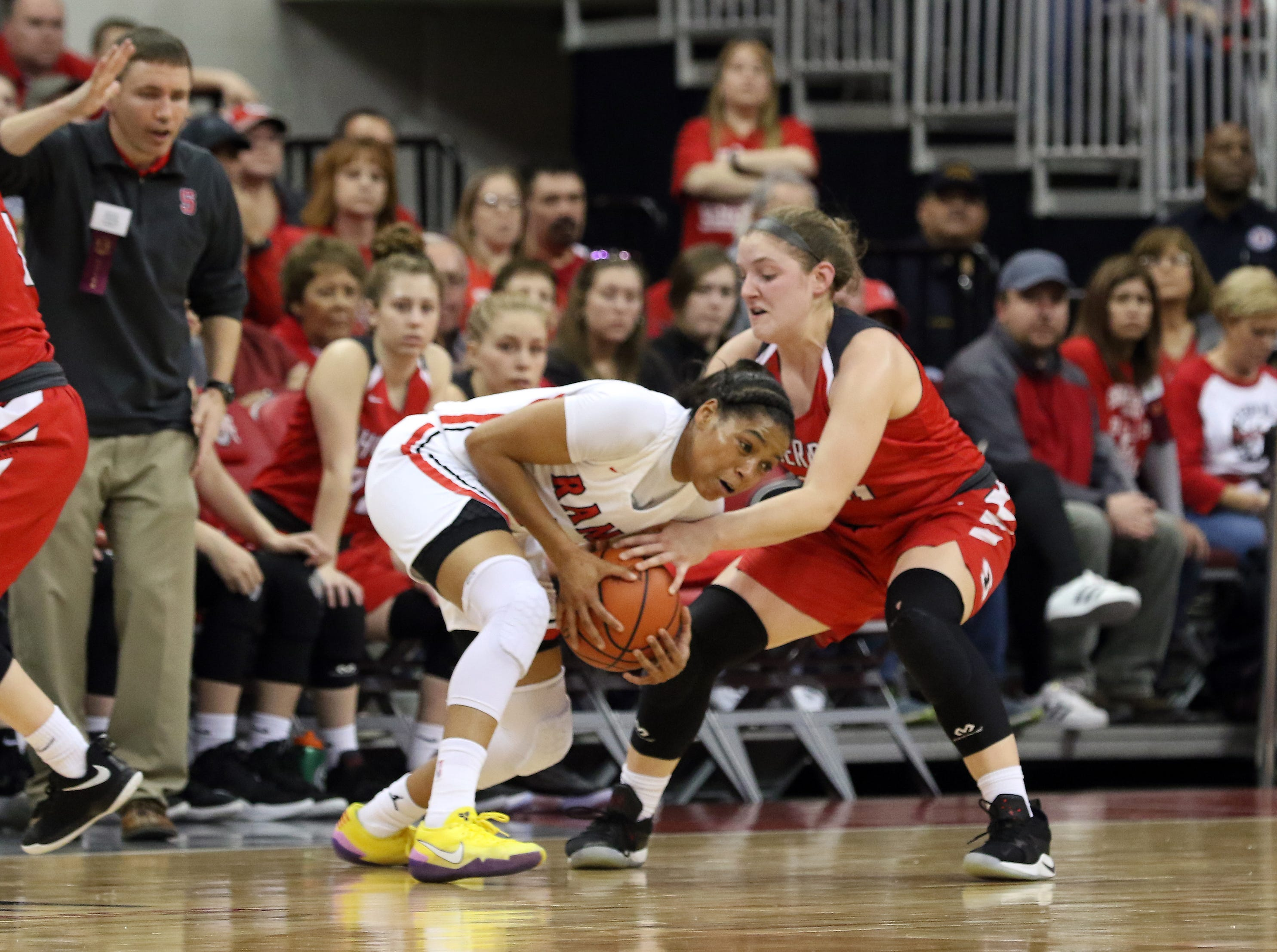 Sheridan's Kendyl Mick defends against Toledo Rogers during the DII state semis in Columbus on Thursday.