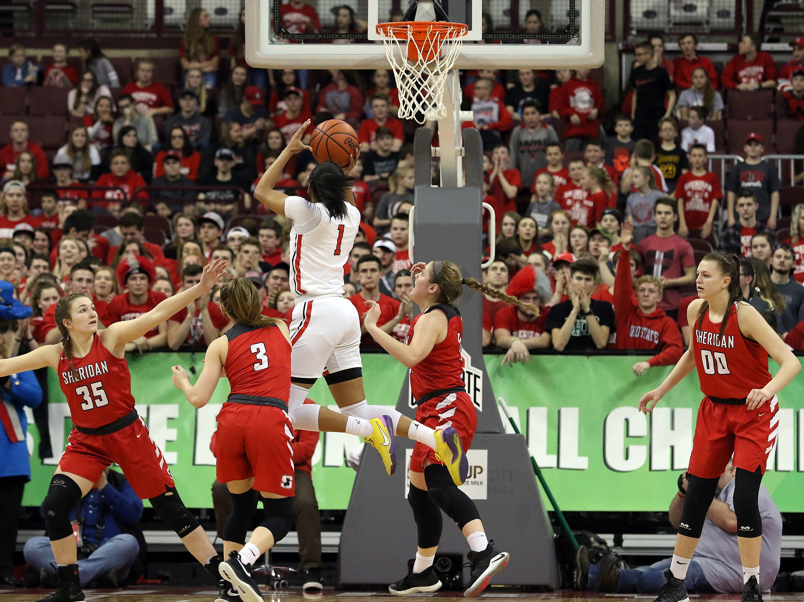 Toledo Rogers' Zia Cooke puts up a shot against Sheridan during the DII state semis in Columbus on Thursday.