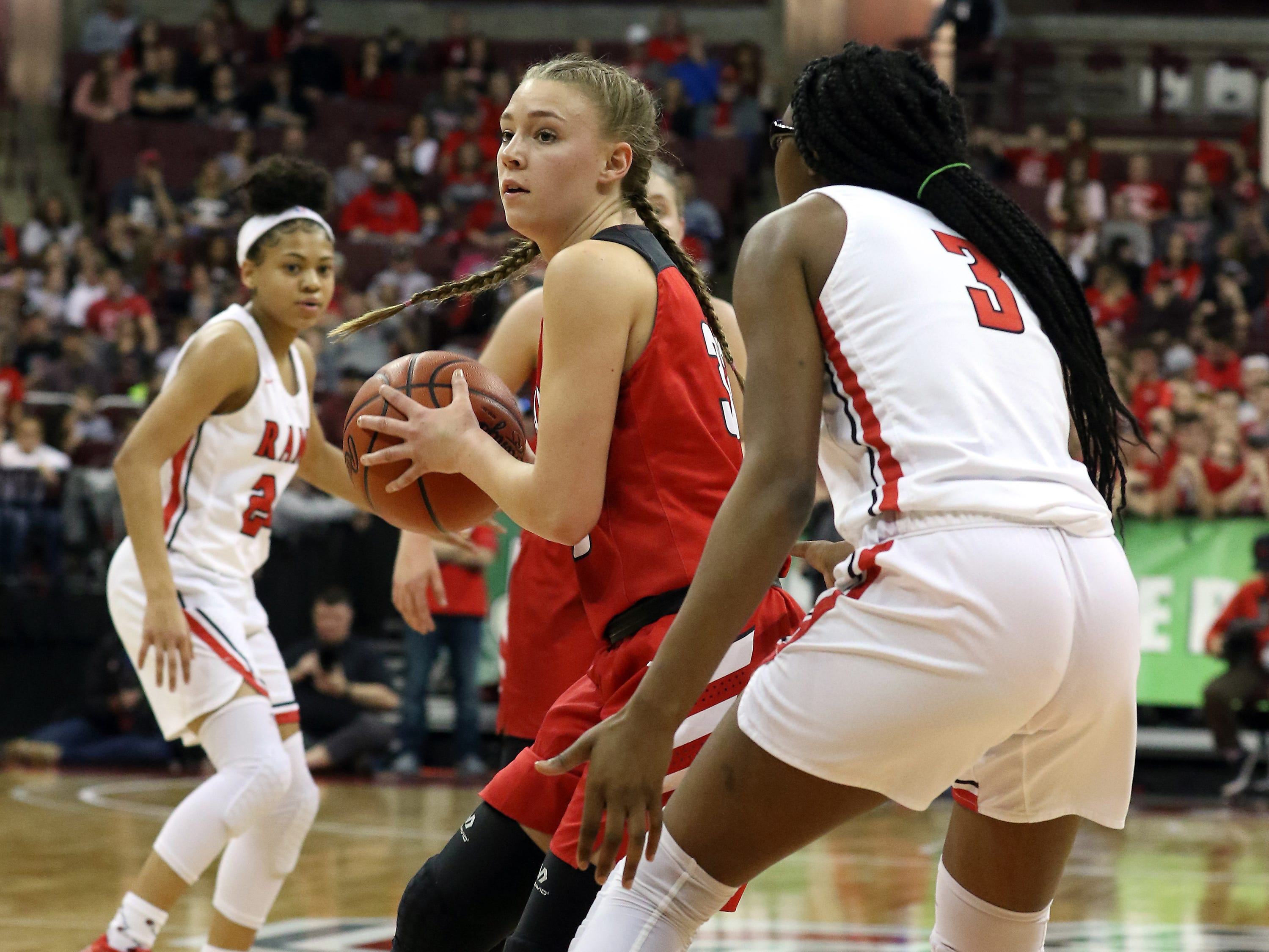 Sheridan's Emma Conrad turns toward the hoop against Toledo Rogers during the DII state semis in Columbus on Thursday.