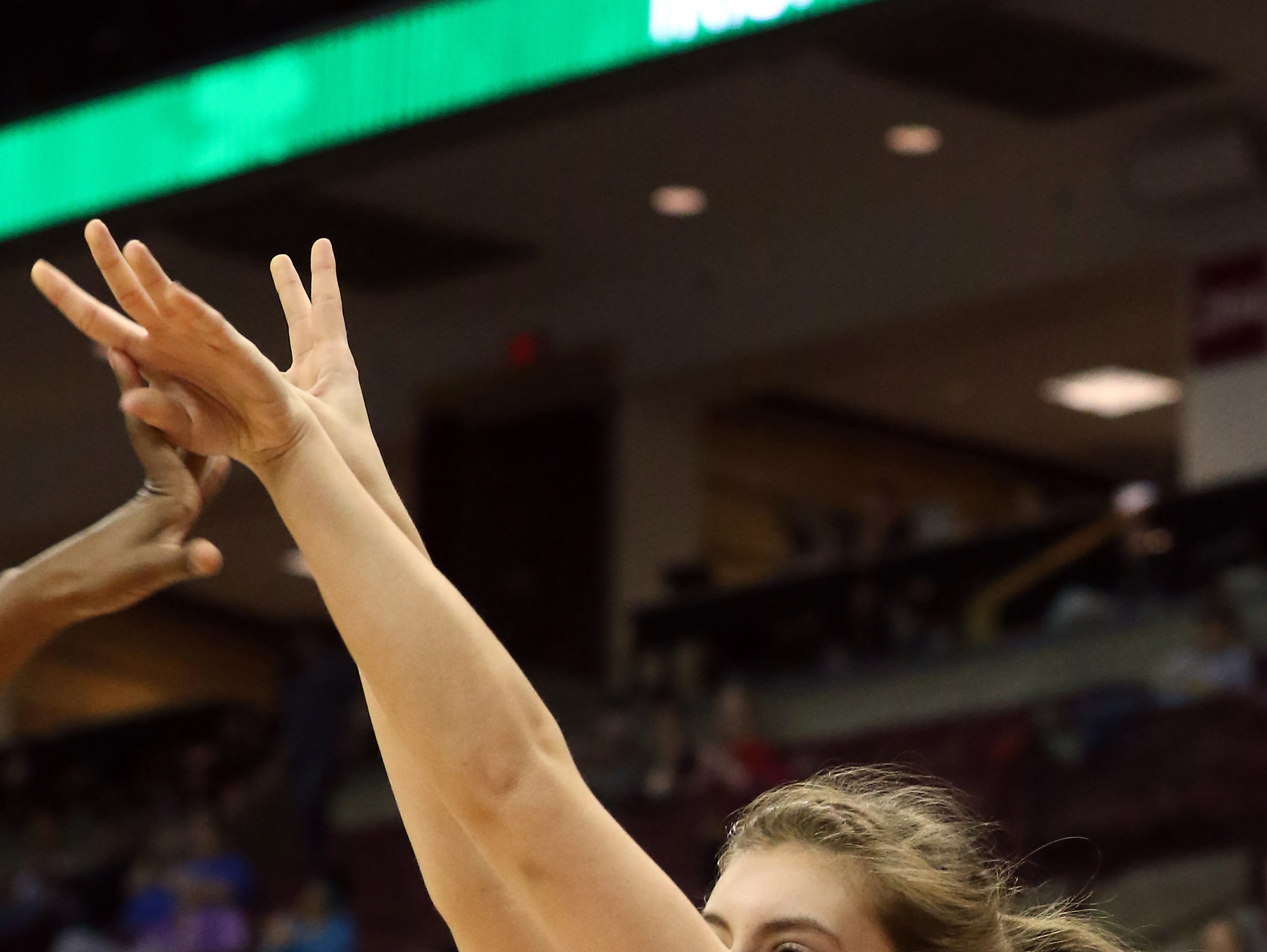 Sheridan's Aubrie White follows through on a three against Toledo Rogers during the DII state semis in Columbus on Thursday.