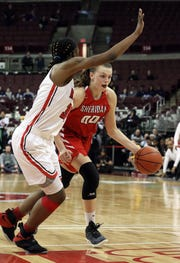 Sheridan's Faith Stinson drives past Toledo Roger's Tanaziah Hines during the Division II state semis in Columbus on Thursday.