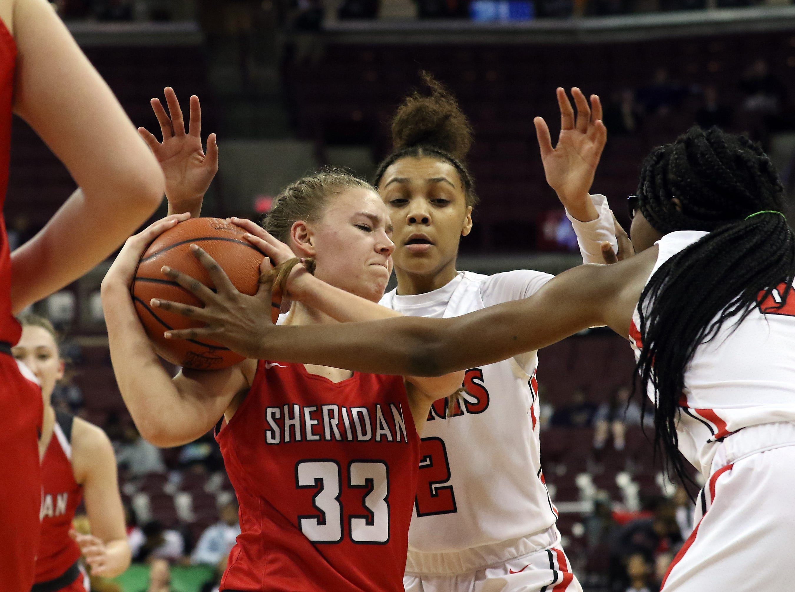 Sheridan's Emma Conrad fights for possession against Toledo Rogers during the DII state semis in Columbus on Thursday.