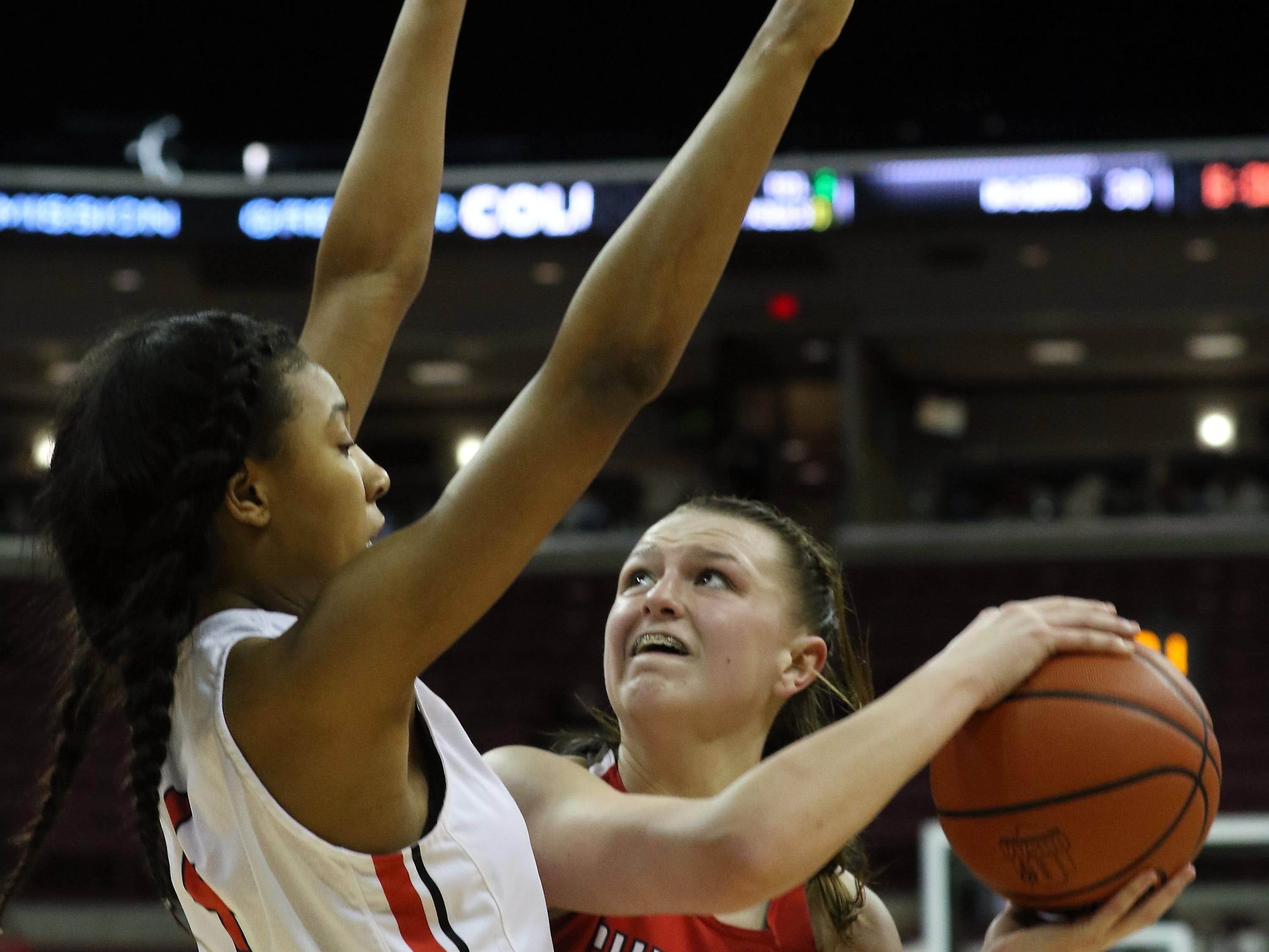 Sheridan's Faith Stinson fights to get off a shot against Toledo Rogers during the DII state semis in Columbus on Thursday.