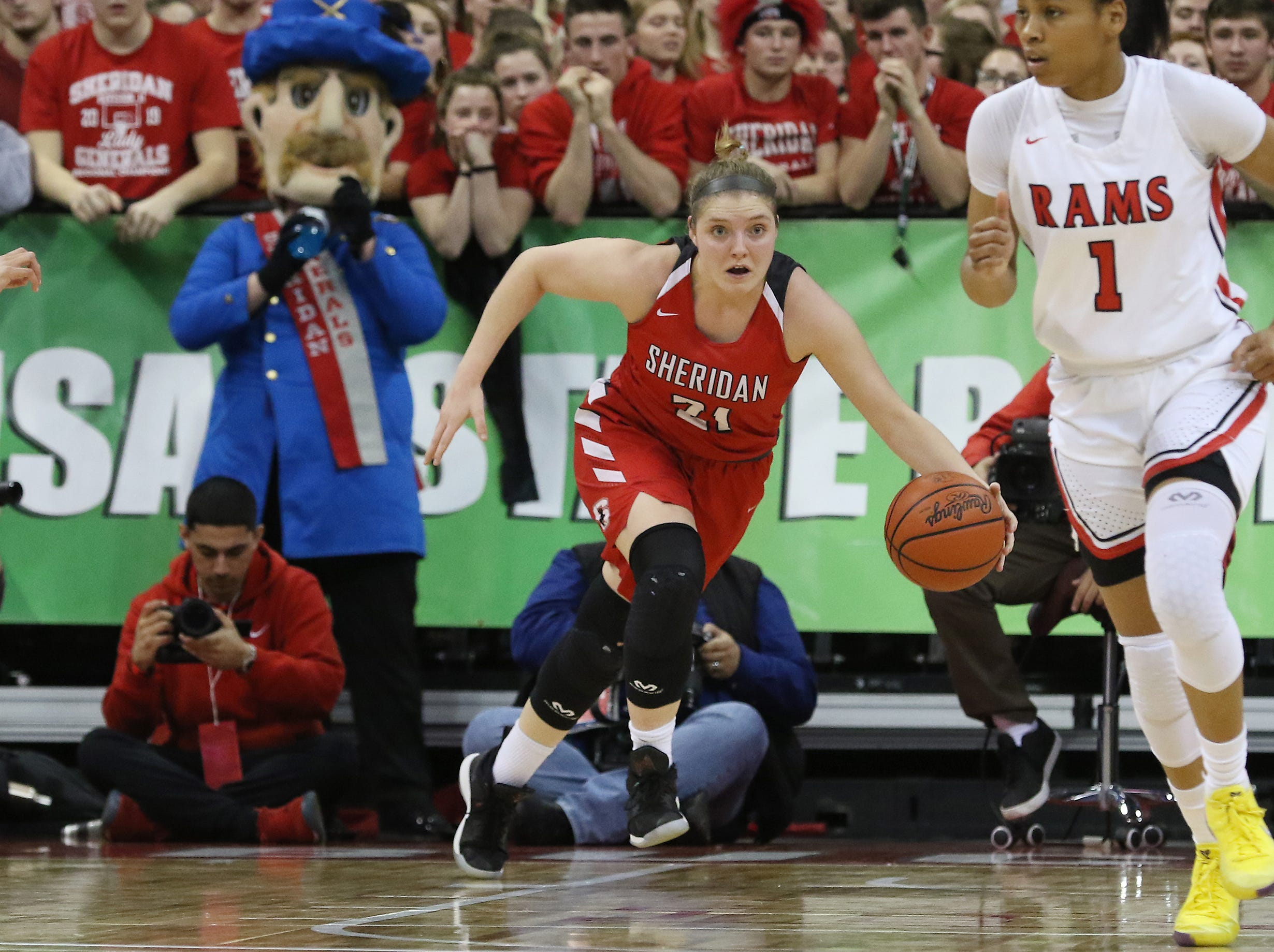 Sheridan's Kendyl Mick brings the ball up the court against Toledo Rogers during the DII state semis in Columbus on Thursday.