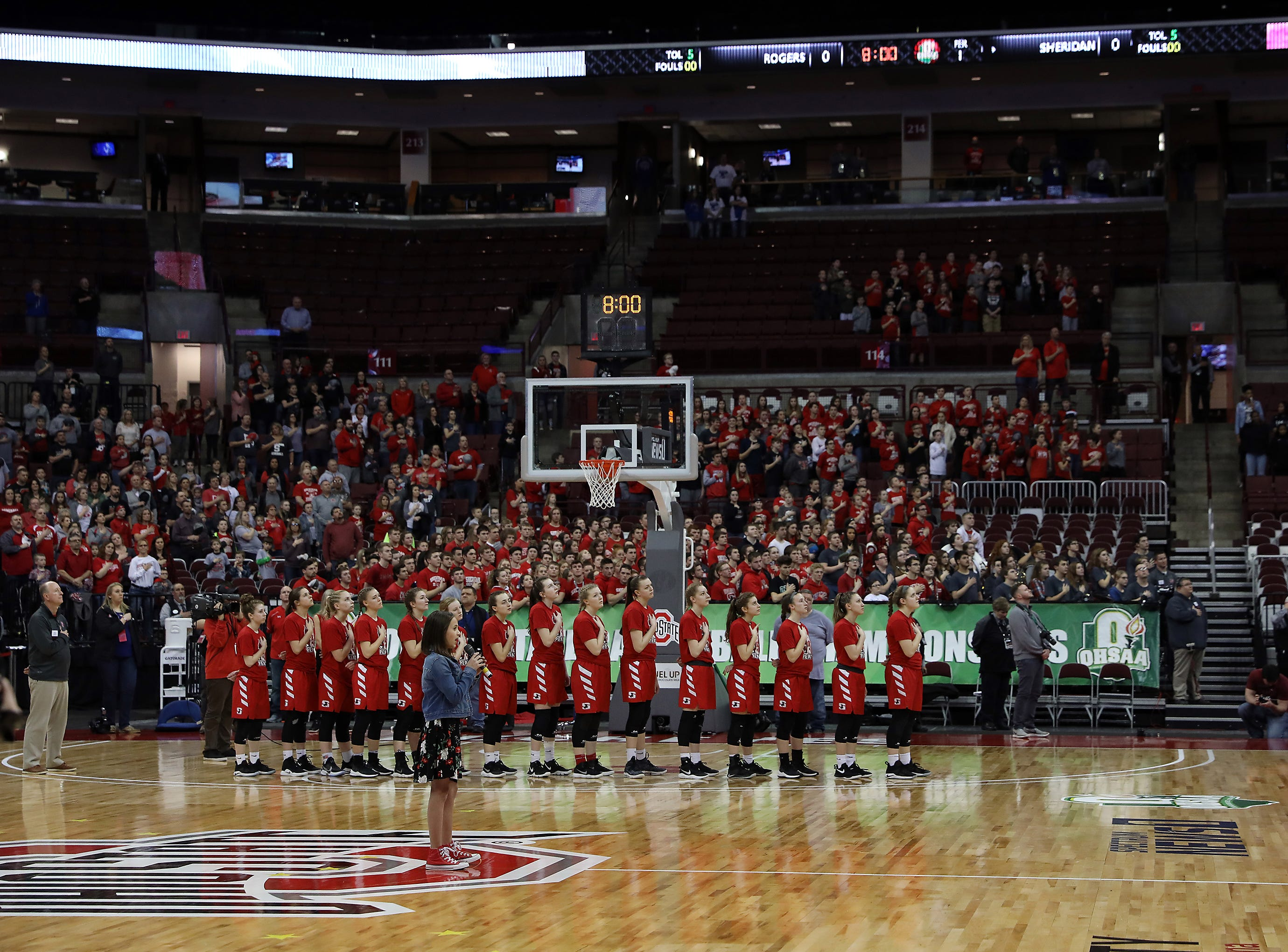 Northern Local Schools elementary school student Dylan Fox sings the national anthem before Thursday's state semifinal.