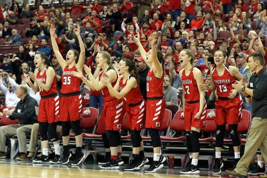 The Sheridan bench celebrates after a play against Toledo Rogers during the DII state semis in Columbus on Thursday.