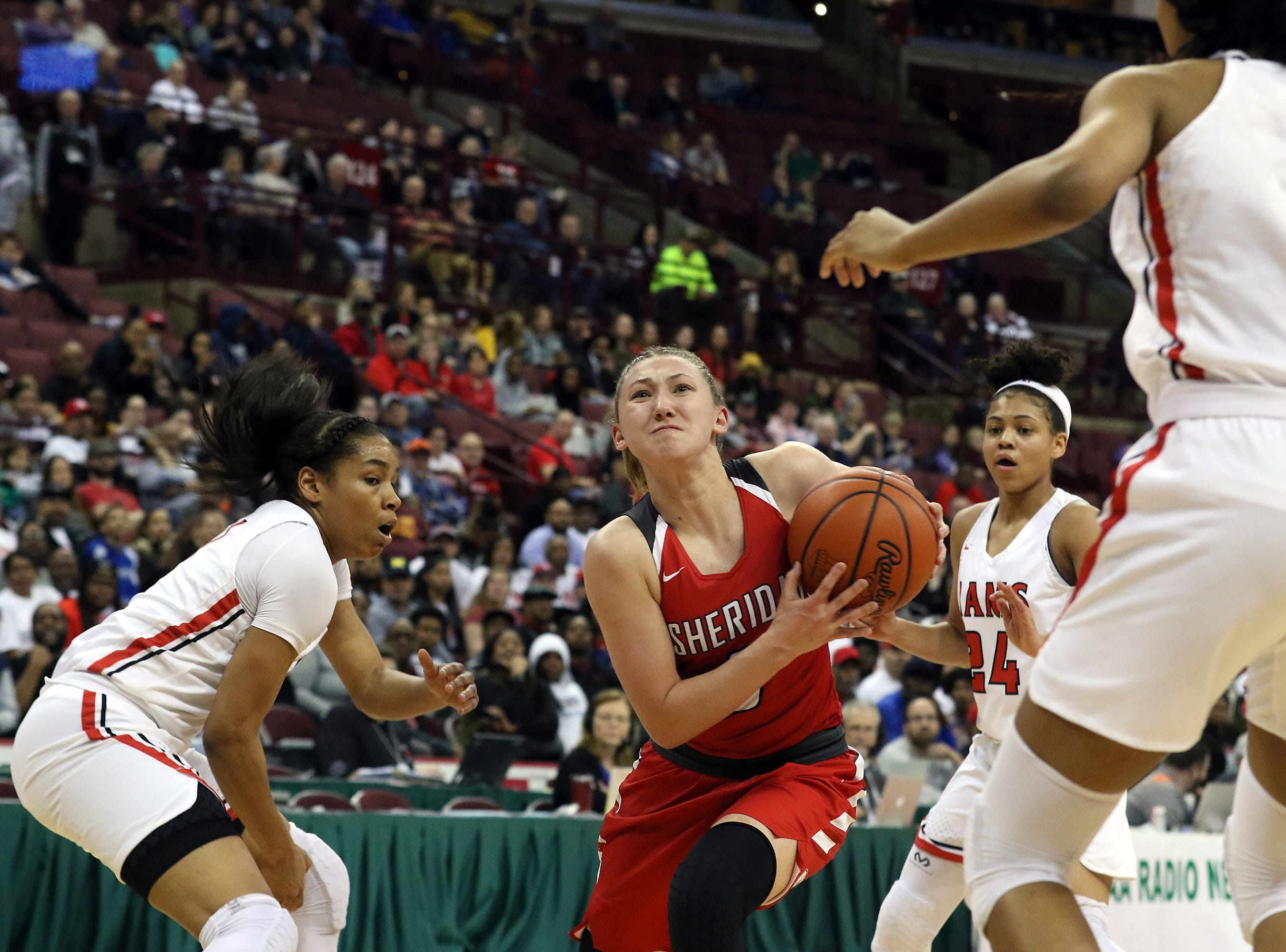 Sheridan's Bailey Beckstedt drives to the hoop against Toledo Rogers during the DII state semis in Columbus on Thursday.