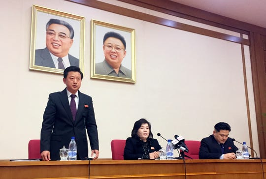 North Korean Vice Foreign Minister Choe Son Hui, center, speaks at a gathering for diplomats in Pyongyang, North Korea on Friday, March 15, 2018. North Korean leader Kim Jong Un will soon make a decision on whether to continue diplomatic talks and maintain the country's moratorium on missile launches and nuclear tests, the senior North Korean official said, noting the U.S. threw away a golden opportunity at the recent summit between their leaders. Interpreter is on Choe's right and the man standing is unidentified vice director of foreign ministry's North America desk.