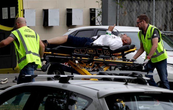 Ambulance staff take a man from outside a mosque in the New Zealand city of Christchurch on Friday.