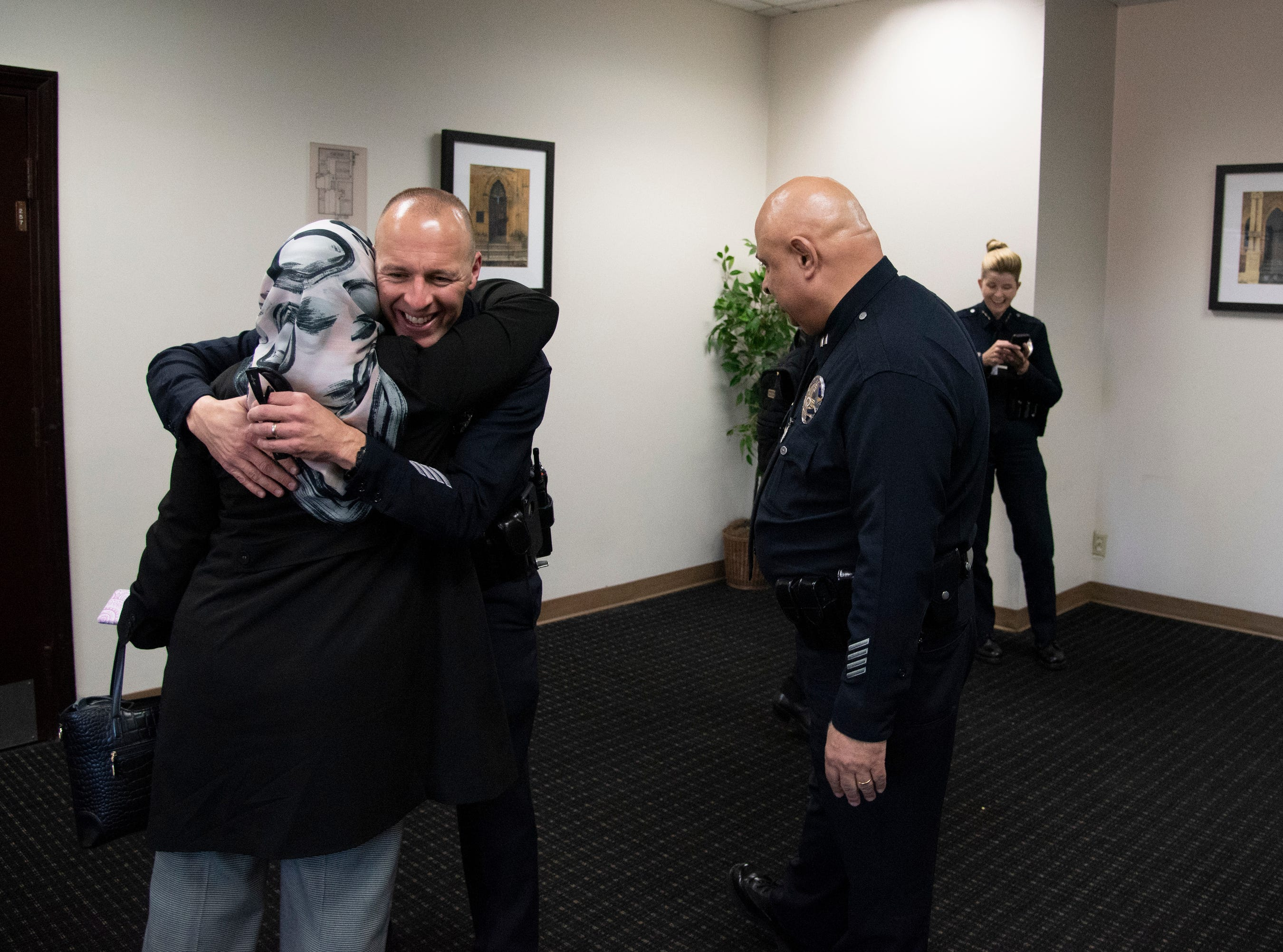 Hedab Tarifi, previous chairperson of the Southern California Islamic Center meet and talk with various LAPD officers before a press conference at the Southern California Islamic Center in Los Angeles, Calif. on March 15, 2019.